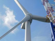Wind turbine erection at sea. Wind Turbine erection offshore sea ocean wind farm royalty free stock image