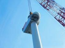 Wind turbine erection at sea. Wind Turbine erection offshore sea ocean wind farm stock photography