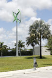 Wind Turbine and EV Charging Center. Fort Lauderdale, FL, USA - May 16, 2017: Urban wind turbine with an EV charging center. Electric vehicle charging center Royalty Free Stock Image