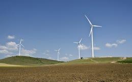 Wind turbine farm. A wind turbine farm with blue sky behind Royalty Free Stock Images