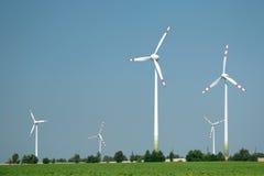 Wind turbine farm. On a green field Royalty Free Stock Photos