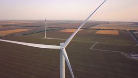 Wind turbine farm from aerial view by drone. Renewable energy, sustainable development, environment friendly concept. Aerial shot with seed fields in stock video footage
