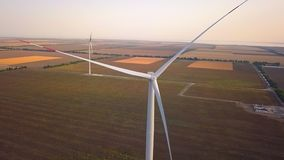 Wind turbine farm from aerial view by drone. Renewable energy, sustainable development, environment friendly concept. Aerial shot with seed fields in stock video