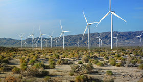 Wind turbine farm and array. Wind turbine farm in California desert with backdrop of mountains Stock Photos