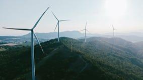 Wind turbine farm on beautiful evening mountain landscape. Renewable energy production for green ecological world. Flat