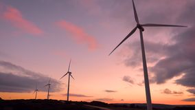 Wind turbine farm on beautiful purple sunset mountain landscape. Renewable ecological energy production. Wind turbine farm on beautiful purple sunset mountain stock video