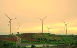 Wind turbine farm during beautiful sunset, Alternative energy