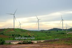 Wind turbine farm during beautiful sunset, Alternative green energy for protection of nature at  Khao Kho, Phetchabun, Thailand Stock Photos