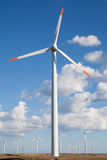 Wind turbine farm, clouded sky. Wind turbine farm over the blue clouded sky Stock Image