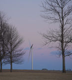 Wind turbine on a farm field Royalty Free Stock Photo