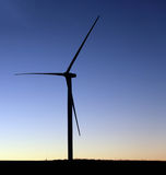 Wind turbine on a farm field Stock Images