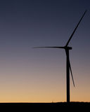 Wind turbine on a farm field Royalty Free Stock Photography