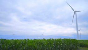 Wind turbine farm on green field. Wind turbines against clouds sky stock footage