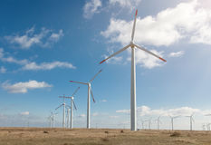 Wind turbine farm over the blue clouded sky Stock Photography