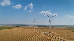 Wind turbine farm over the blue sky. Wind turbine farm over the blue clouded sky Royalty Free Stock Photography