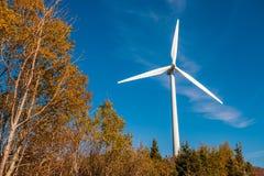 Wind turbine farm. Over blue sky at sunset Stock Photo