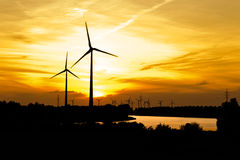 Wind turbine farm over sunset Stock Photo