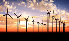 Wind turbine farm over sunset Stock Image
