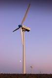 Wind turbine farm with purple sky Stock Images