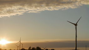 Wind turbine farm with rays of light at sunset stock video footage