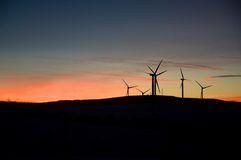 Wind turbine farm at sunset. Wind turbine farm with rays of light at sunset. Rusova - Krusne Hory - Czech Republic stock photography