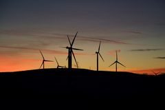 Wind turbine farm at sunset Royalty Free Stock Photography