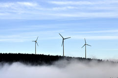 Wind turbine farm at sunset Stock Photo