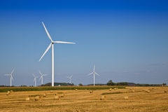 Wind Turbine on the farmer field. White Wind Turbine on the farmer field Royalty Free Stock Photos