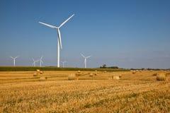 Wind Turbine on the farmer field. White Wind Turbine on the farmer field Royalty Free Stock Images