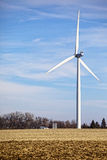 Wind turbine in field Royalty Free Stock Photos