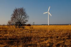Wind turbine in field royalty free stock photo