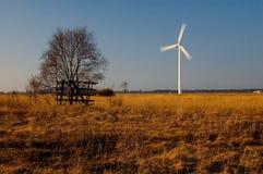 Wind turbine in field Royalty Free Stock Photo