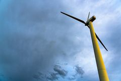 Wind turbine on blue sky royalty free stock image