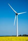 Wind turbine in a flower field of rapeseed Royalty Free Stock Image