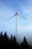 Wind Turbine in a Forest in Mist Royalty Free Stock Images