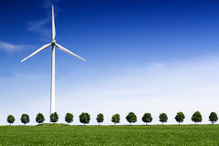 Wind Turbine on front of a green wheat field Royalty Free Stock Image