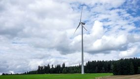 Wind Turbine. Generating clean electrical energy in partly cloudy weather stock video