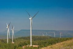 Wind turbine generating electricity with blue sky.  royalty free stock photography