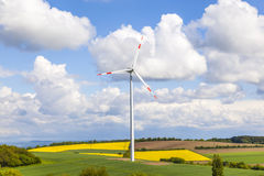 Wind turbine generating electricity. On blue sky royalty free stock photos