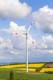 Wind turbine generating electricity. On blue sky royalty free stock photography
