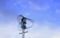 Wind turbine generating. Electricity on blue sky stock photography