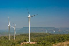 Wind turbine generating electricity with blue sky.  royalty free stock images