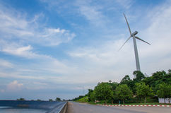 wind turbine generating electricity on dam catchment Royalty Free Stock Photos