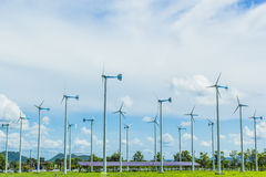 Wind turbine. Generating electricity with solar cells Stock Images