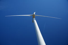 Wind turbine generator. An upward shot of a wind turbine generator with three wind blades. Blue sky above the windmill. Location in North Cape, Prince Edward Stock Photography