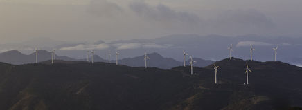 Wind turbine generator on mountain panorama Royalty Free Stock Images