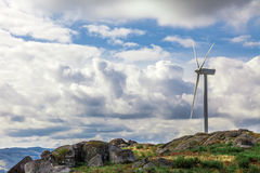 Wind turbine generator on top a hill Stock Images