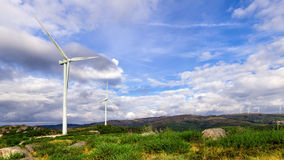 Wind turbine generators on top a hill Royalty Free Stock Images