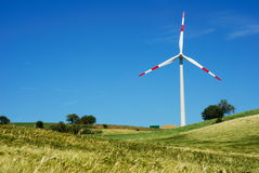 Wind turbine and golden field Royalty Free Stock Image