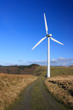 Wind turbine with gravel path Royalty Free Stock Images